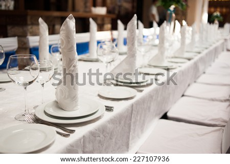 Nicely served wedding table in a restaurant - stock photo