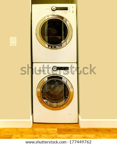Niche in the ivory wall for washer and dryer. Great design idea when there is no laundry room - stock photo