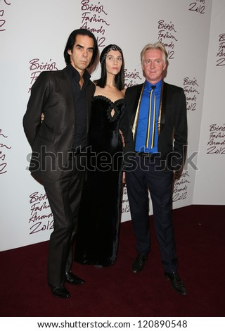Nick Cave, Susie Bick, Philip Treacy arriving for The British Fashion Awards 2012 held at The Savoy, London. 27/11/2012 Picture by: Henry Harris / Featureflash