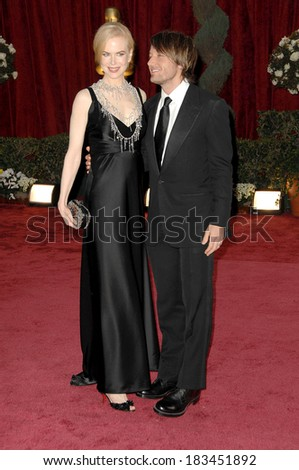 Nicole Kidman, in Balenciaga dress, L'Wren Scott necklace, Bottega Veneta clutch, Keith Urban at 80th Annual Academy Awards Oscars Ceremony, The Kodak Theatre, LA, Febr 24, 2008 - stock photo