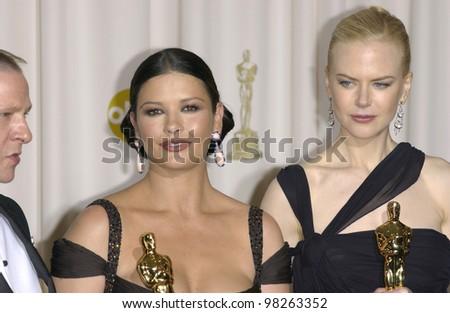 NICOLE KIDMAN (right) & CATHERINE ZETA-JONES at the 75th Academy Awards at the Kodak Theatre, Hollywood, California. March 23, 2003 - stock photo