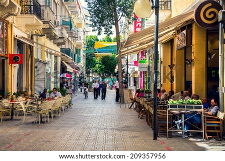 NICOSIA, CYPRUS - JUNE 3, 2014: Typical street in Nicosia, on June 3, 2014. The city is one of the top tourist attractions in Cyprus because ot its architecture, history and climate.