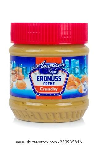 NIEDERSACHSEN, GERMANY DECEMBER 26.12.2014: A jar of American Style German Erdnuss Creme crunchy peanut butter on a white background  - stock photo