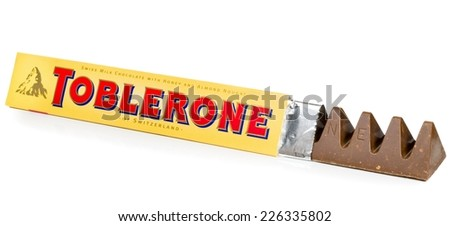 NIEDERSACHSEN, GERMANY OCTOBER 25, 2014: A bar of Toblerone milk chocolate on a white background - stock photo