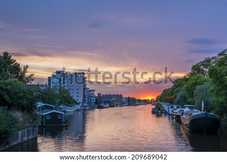 Nieuwevaart canal, Amsterdam 2. I used an excellent app to find a location for this shot. It calculated that the sun would be setting at the end of the canal- and it was perfect! - stock photo