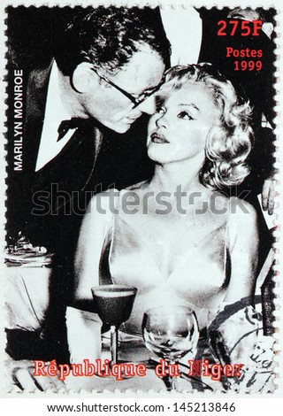 NIGER - CIRCA 1999: A postage stamp printed by NIGER shows image portrait of famous American actress Marilyn Monroe and Arthur Miller, circa 1999 - stock photo