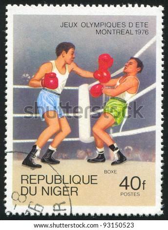 NIGER - CIRCA 1976: stamp printed by Niger, shows boxing, circa 1976. - stock photo