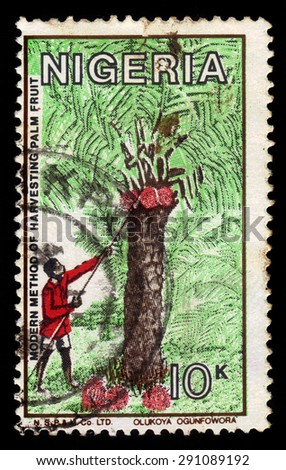 NIGERIA - CIRCA 1986: A stamp printed in Nigeria, shows modern method of harvesting palm fruit, coconut harvest, circa 1986 - stock photo