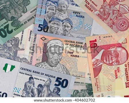 Nigeria money, heap of various naira banknotes, African nigerian currency - stock photo