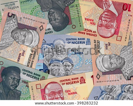 Nigeria money, heap of various nigerian  naira banknotes, currency background  - stock photo