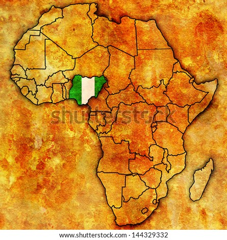 nigeria on actual vintage political map of africa with flags - stock photo