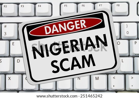 Nigerian Scam Danger Sign,  A red and white sign with the words Nigerian Scam on a keyboard - stock photo