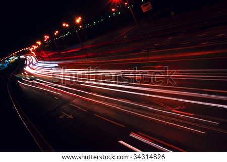 Nigh highway. Cars headlights in motion blur. Long exposure shot. Moscow, Russia - MKAD. Tilt view. - stock photo