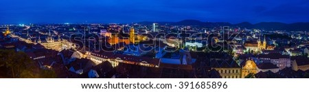 night aerial view over the illuminated austrian city graz