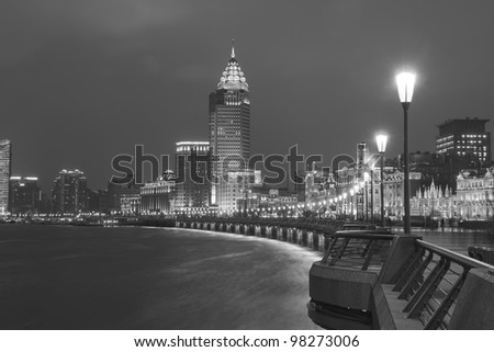 Night at the Bund, Shanghai, China This is a photo of the Bund - the famous place in Shanghai, China. The buildings here are all very old with great history. - stock photo