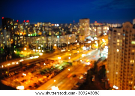night city view from above Blurred defocused night lights. - stock photo