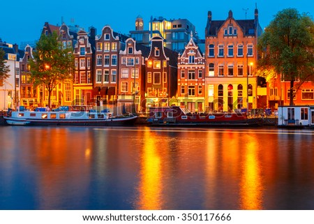 Night city view of Amsterdam canal, typical dutch houses and boats, Holland, Netherlands. - stock photo