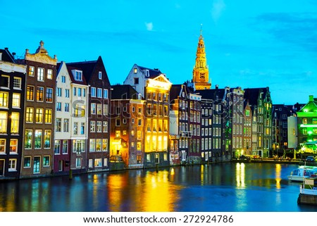 Night city view of Amsterdam, the Netherlands with canal - stock photo