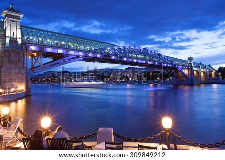 night cityscape of Moscow with river and illumination bridge Andreevsky - stock photo