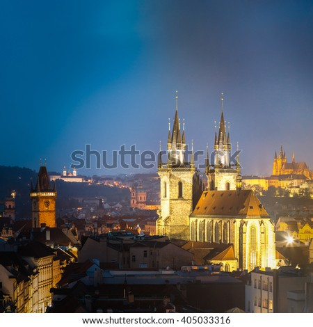Night cityscape of Prague, Czech Republic. Famous Old town hall, Church Of Our Lady Before Tyn, St. Vitus Cathedral