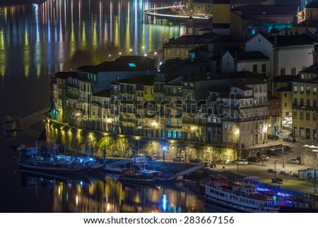 night cityscape view city of Porto and Douro river in Portugal - stock photo