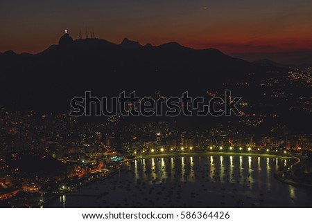 Night cityscape view from the Sugarloaf mountain on the Guanabara bay, Botafogo beach and district, Corcovado mountain with Christ the Redemeer. Rio de Janeiro, Brazil.