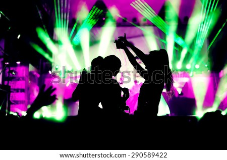 night club festival crowd hands up dance with girls silhouettes