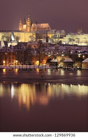 Night colorful snowy Prague gothic Castle with Charles Bridge, Czech republic