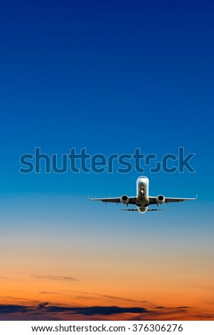 Night (dawn, dusk ) flight of the airplane (jet) over the beautiful night sky. - stock photo