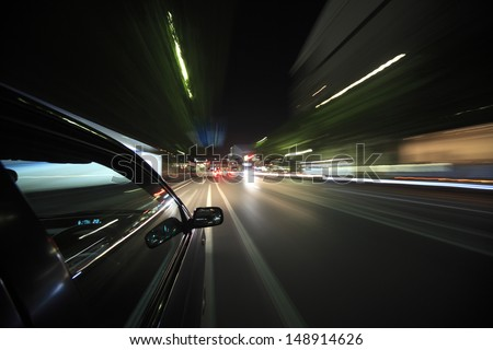 Night drive with car in motion. - stock photo