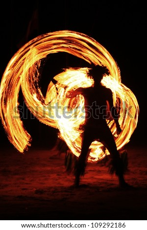 Night fire show on the beach - stock photo