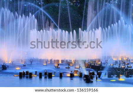 Night fountain in the park - stock photo