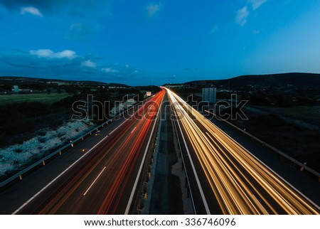 Night highway. Lights of moving cars. Cyprus