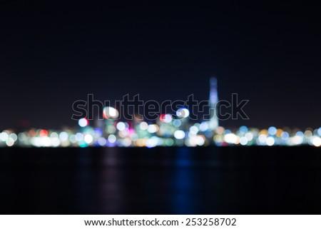 Night illuminated cityscape abstract blurred background - stock photo