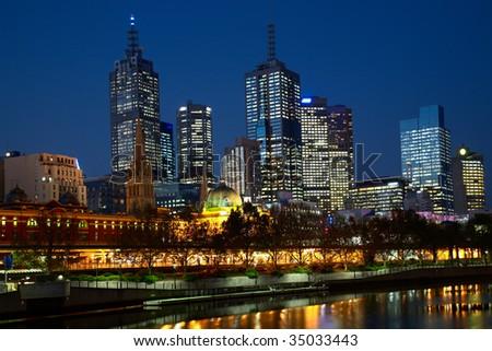 Night illumination in center of Melbourne city - stock photo