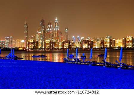 Night illumination of the luxury hotel beach on Palm Jumeirah man-made island, Dubai, UAE - stock photo
