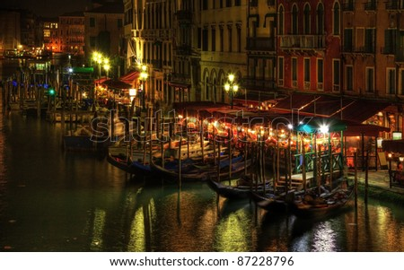 Night image in Venice on the Grand Canal in the vicinity of the Rialto Bridge.