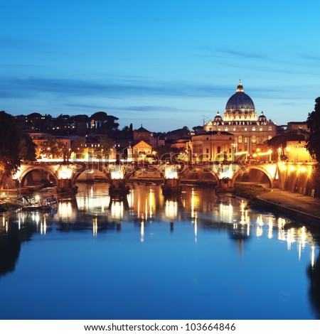 Night image of St. Peter's Basilica, Ponte Sant Angelo and Tiber River in Rome - Italy. - stock photo