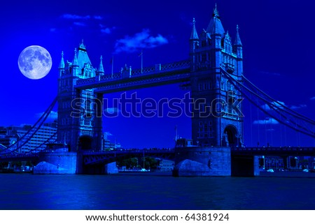 Night image of Tower Bridge in London with a full moon - stock photo