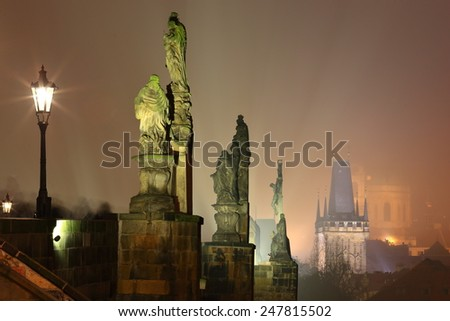 Night image with the Charles bridge and religious statues in foggy night, Prague, Czech Republic - stock photo