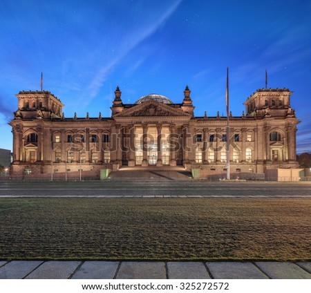 "Night in Berlin. Glowing Reichstag building facade seen from the former Konigsplatz . ""German nation"" label on facade - stock photo"