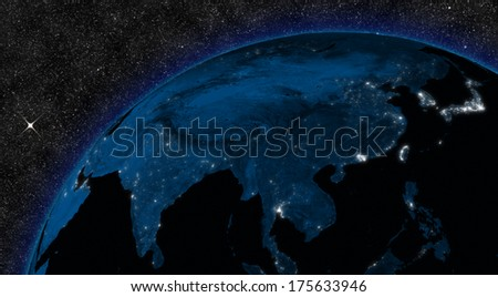 Night in East Asia region with city lights viewed from space. Elements of this image furnished by NASA. - stock photo