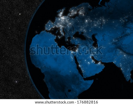 Night in Europe, Middle East and Africa region with city lights viewed from space. Elements of this image furnished by NASA. - stock photo