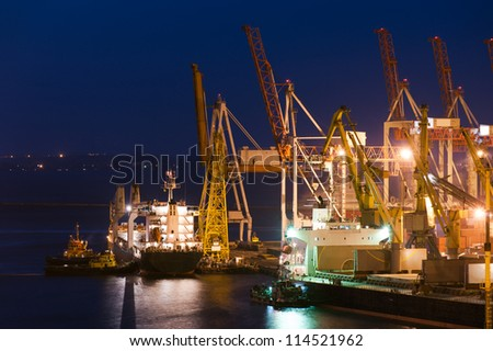 night industrial port and cranes - stock photo