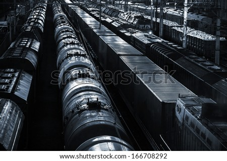 Night industrial railway perspective with oil tank wagons - stock photo