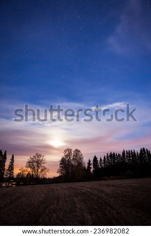 Night landscape and cloudy starry sky - stock photo