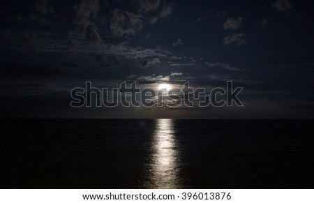Night landscape of the sea, moonlit path - stock photo