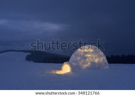 Night landscape. Snow igloo in mountains. Extreme housing for tourists - stock photo