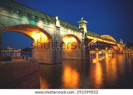 night landscape with covered bridge Andreevsky in Moscow, Russia. instagram image filter retro style - stock photo