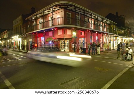 Night life with lights on Bourbon Street in French Quarter New Orleans, Louisiana - stock photo